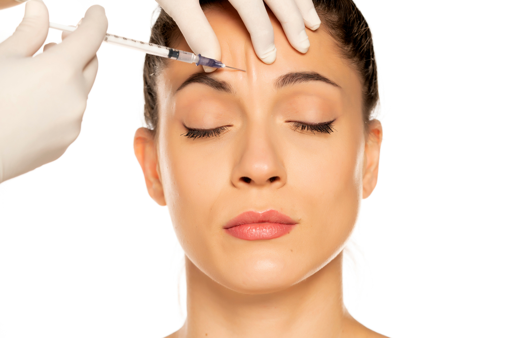 woman receiving forehead injections