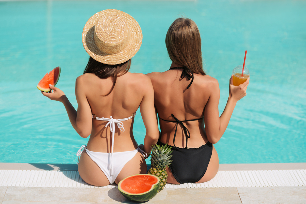 two woman at a pool
