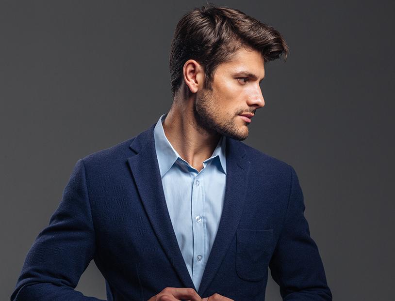 man posing in suit