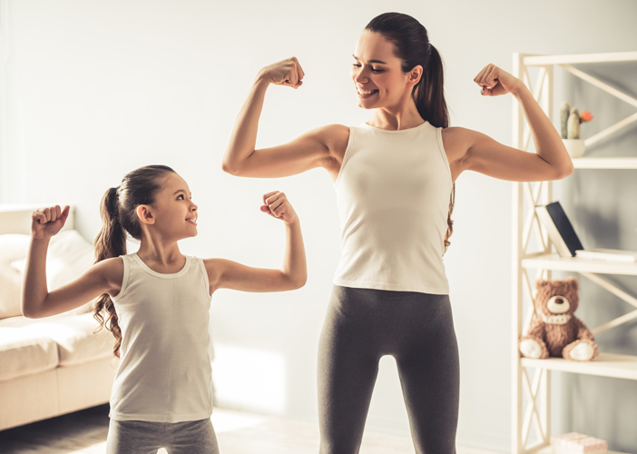 woman and child flexing muscles